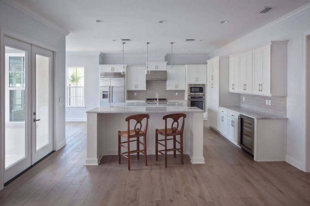 Open concept kitchen with two islands and breakfast nook